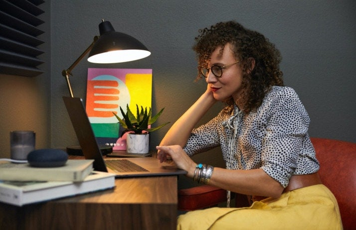 Woman using image editor feature on her website